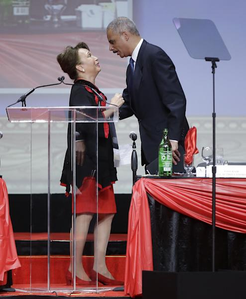 """Attorney General Eric Holder, right, is introduced by Alexis Margaret Herman, left, before speaking at the Delta Sigma Thetas Social Action luncheon, part of the sorority's 51st National Convention in Washington, Monday, July 15, 2013. Holder said the killing of Trayvon Martin was a """"tragic, unnecessary shooting"""" and that the 17-year-old's death provides an opportunity for the nation to speak honestly about complicated and emotionally charged issues. In his first comments since the acquittal of George Zimmerman in the Martin case, the attorney general said that Martin's parents have suffered a pain that no parent should have to endure. He said the nation must not forgo an opportunity toward better understanding of one another. (AP Photo/Pablo Martinez Monsivais)"""
