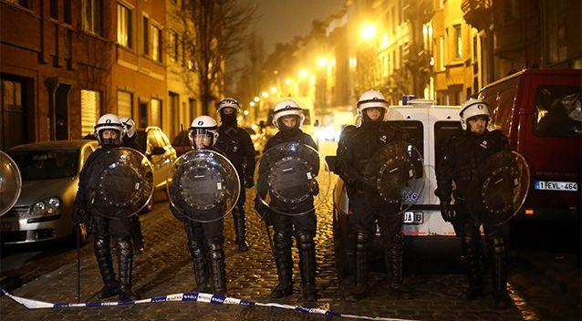 Police officers patrol after raids in which several people, including Paris attacks suspect Salah Abdeslam, were arrested on March 18, 2016. Photo: Getty Images