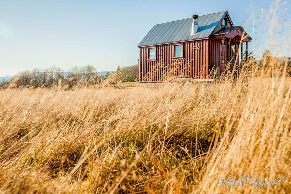 """<p>This 112-square-foot mobile cabin belongs to extreme skier <a href=""""http://www.fyi.tv/shows/tiny-house-nation/cast/zack-giffin"""" rel=""""nofollow noopener"""" target=""""_blank"""" data-ylk=""""slk:Zac Giffin"""" class=""""link rapid-noclick-resp"""">Zac Giffin</a>, the host of FYI's <em><a href=""""http://www.fyi.tv/shows/tiny-house-nation"""" rel=""""nofollow noopener"""" target=""""_blank"""" data-ylk=""""slk:Tiny House Nation"""" class=""""link rapid-noclick-resp"""">Tiny House Nation</a>, </em>a show that features people from across the country who are living the tiny house lifestyle. The tiny abode is home to Giffin and his girlfriend, skier Molly Baker. Built on a trailer, the house features a little wood stove, living space, and a lofted guest bedroom and storage area accessed by a floating staircase. <a href=""""http://www.nytimes.com/2014/07/03/garden/so-small-but-already-a-tv-star.html"""" rel=""""nofollow noopener"""" target=""""_blank"""" data-ylk=""""slk:Built by Giffin for almost $25,000"""" class=""""link rapid-noclick-resp"""">Built by Giffin for almost $25,000</a>, the structure took seven weeks to complete. </p><p><a class=""""link rapid-noclick-resp"""" href=""""https://go.redirectingat.com?id=74968X1596630&url=http%3A%2F%2Fwww.tumbleweedhouses.com%2Fblogs%2Ftumbleweed%2F6936000-ski-lodge-on-wheels&sref=https%3A%2F%2Fwww.oprahdaily.com%2Flife%2Fg35047961%2Ftiny-house%2F"""" rel=""""nofollow noopener"""" target=""""_blank"""" data-ylk=""""slk:SEE INSIDE"""">SEE INSIDE</a></p>"""