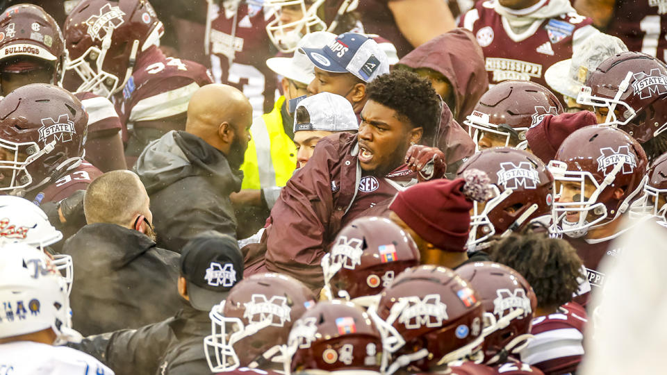 A fight breaks out after the game cancelling the trophy presentation after the Armed Forces Bowl game between the Tulsa Golden Hurricane and the Mississippi State Bulldogs. (Photo by Matthew Pearce/Icon Sportswire via Getty Images)