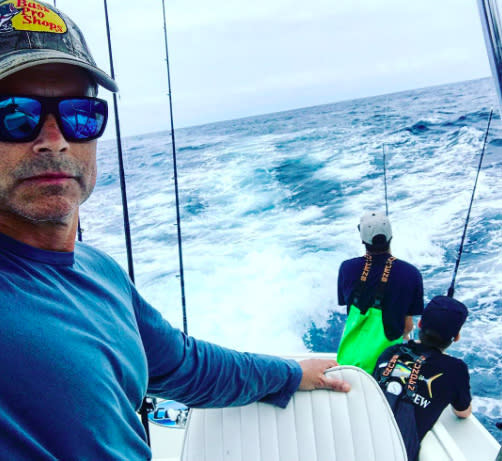 "<p>Gone fishin'! The actor sported a Bass Pro Shops hat (and a little scruff) while on his ocean adventure: ""Everyone needs their crew."" (Photo: <a href=""https://www.instagram.com/p/BU0eDvYBhDD/"" rel=""nofollow noopener"" target=""_blank"" data-ylk=""slk:Rob Lowe via Instagram"" class=""link rapid-noclick-resp"">Rob Lowe via Instagram</a>) </p>"