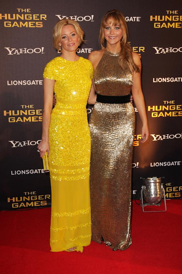 LONDON, ENGLAND - MARCH 14:  (UK TABLOID NEWSPAPERS OUT) L-R Elizabeth Banks and Jennifer Lawrence attend the European premiere of The Hunger Games at The O2 Arena on March 14, 2012 in London, England.  (Photo by Dave Hogan/Getty Images)