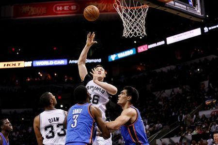 May 21, 2014; San Antonio, TX, USA; San Antonio Spurs forward Aron Baynes (16) shoots the ball over Oklahoma City Thunder forward Perry Jones (3) and center Steven Adams (right) in game two of the Western Conference Finals of the 2014 NBA Playoffs at AT&T Center. Soobum Im-USA TODAY Sports