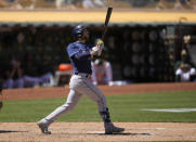 Tampa Bay Rays' Brandon Lowe watches the flight of his two-run home run during the sixth inning of a baseball game against the Oakland Athletics, Saturday, May 8, 2021, in Oakland, Calif. (AP Photo/Tony Avelar)