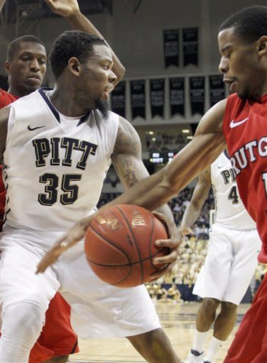 Rutgers' Jerome Seagears, right, strips the ball from Pittsburgh's Nasir Robinson (35) in the first half of the NCAA college basketball game Wednesday, Jan. 11, 2012, in Pittsburgh. (AP Photo/Keith Srakocic)