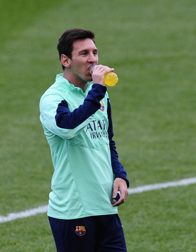 FC Barcelona's Lionel Messi, from Argentina, takes a drink during a training session at the Mini Stadi Stadium in Barcelona, Spain, Friday, Jan. 3, 2014. (AP Photo/Manu Fernandez)