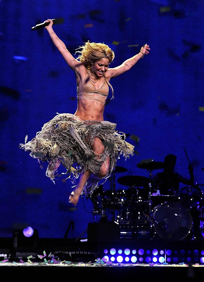 """The ab-tastic crooner comes in for a landing. Will you be buying her new album, <i>Sale el Sol/The Sun Comes Out</i>, when it drops on October 19? Larry Busacca/<a href=""""http://www.gettyimages.com/"""" target=""""new"""">GettyImages.com</a> - September 21, 2010"""