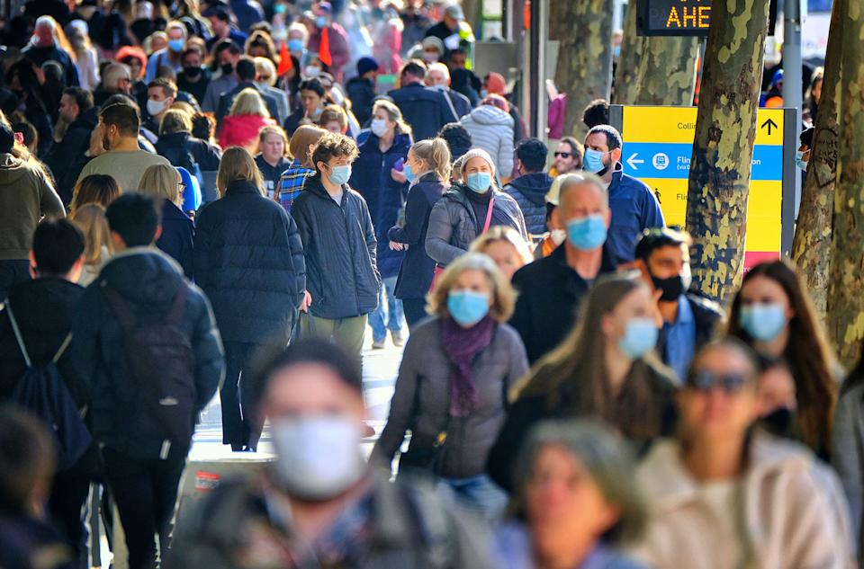 People are seen in the CBD of Melbourne, Thursday, July 8, 2021.