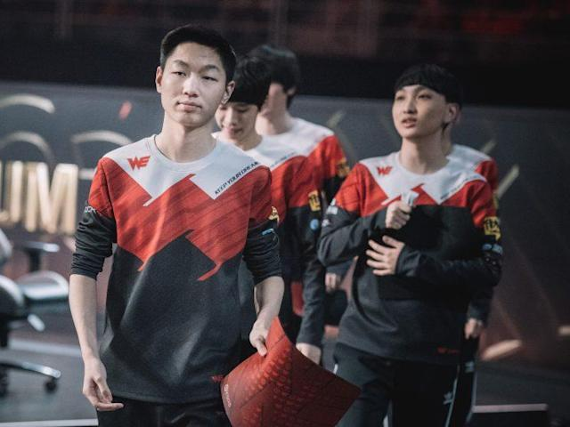 """Xiang """"Condi"""" Renjie walks offstage with Team WE at the 2017 Mid-Season Invitational (Riot Games/lolesports)"""
