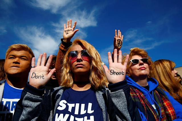 "<p>Attendees are seen before students and gun control advocates hold the ""March for Our Lives"" event demanding gun control after recent school shootings at a rally in Washington, U.S., March 24, 2018. (Eric Thayer/Reuters) </p>"