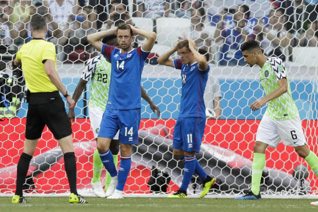 Iceland's Kari Arnason, second left, and Iceland's Alfred Finnbogason, second right, react during the group D match between Nigeria and Iceland at the 2018 soccer World Cup in the Volgograd Arena in Volgograd, Russia, Friday, June 22, 2018. (AP Photo/Andrew Medichini)
