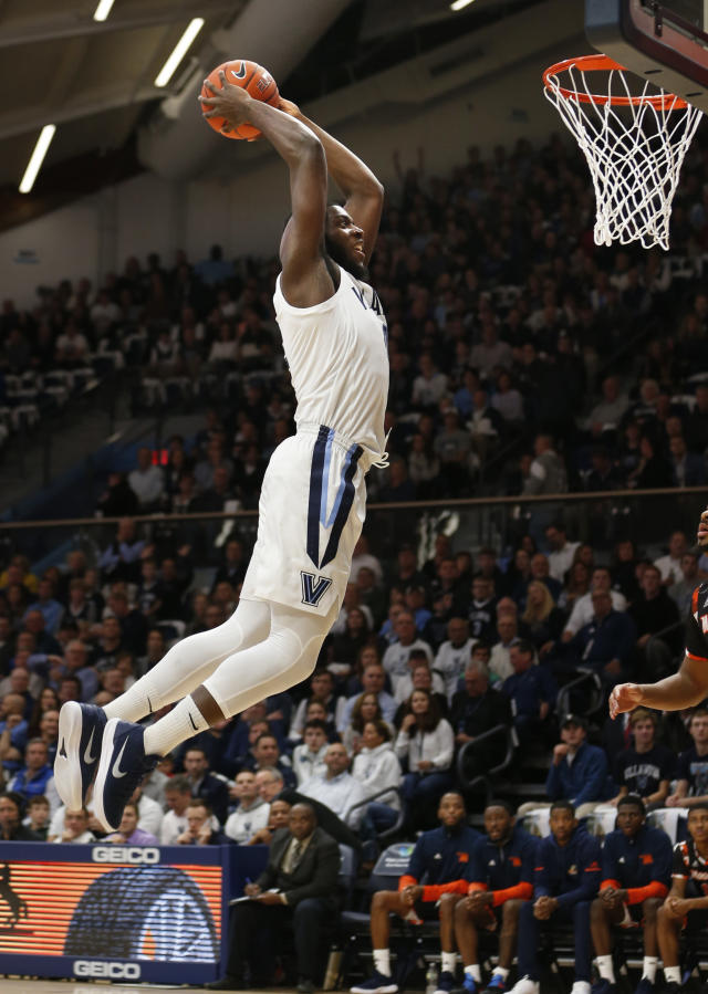 Villanova forward Eric Paschall (4) dunks the ball in the first half of an NCAA college basketball game against Morgan State, Tuesday, Nov. 6, 2018, in Villanova, Pa. (AP Photo/Laurence Kesterson)