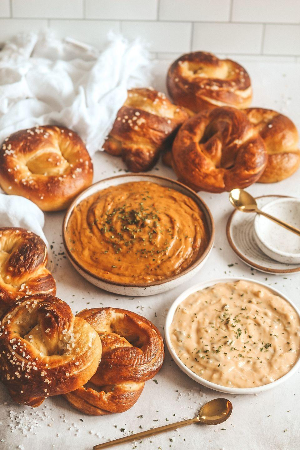 """<p>As if making <em>brioche</em> homemade pretzels wasn't enough, there's also a beer cheese dip made with smoked gouda. Talk about heaven!</p><p><strong>Get the recipe at <a href=""""https://britneybreaksbread.com/index.php/2020/09/11/brioche-pretzels-with-smoked-gouda-beer-cheese-dip/"""" rel=""""nofollow noopener"""" target=""""_blank"""" data-ylk=""""slk:Britney Breaks Bread"""" class=""""link rapid-noclick-resp"""">Britney Breaks Bread</a>.</strong></p><p><b><a class=""""link rapid-noclick-resp"""" href=""""https://go.redirectingat.com?id=74968X1596630&url=https%3A%2F%2Fwww.walmart.com%2Fsearch%2F%3Fquery%3Dstand%2Bmixer&sref=https%3A%2F%2Fwww.thepioneerwoman.com%2Ffood-cooking%2Fmeals-menus%2Fg35049189%2Fsuper-bowl-food-recipes%2F"""" rel=""""nofollow noopener"""" target=""""_blank"""" data-ylk=""""slk:SHOP STAND MIXERS"""">SHOP STAND MIXERS</a></b></p>"""