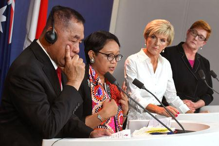 Indonesia's Defence Minister Ryamizard Ryacudu and Foreign Minister Retno Marsudi stand with Australia's Foreign Minister Julie Bishop and Defence Minister Marise Payne during a media conference after their bilateral meeting in Sydney, Australia, March 16, 2018.      William West/Pool via REUTERS