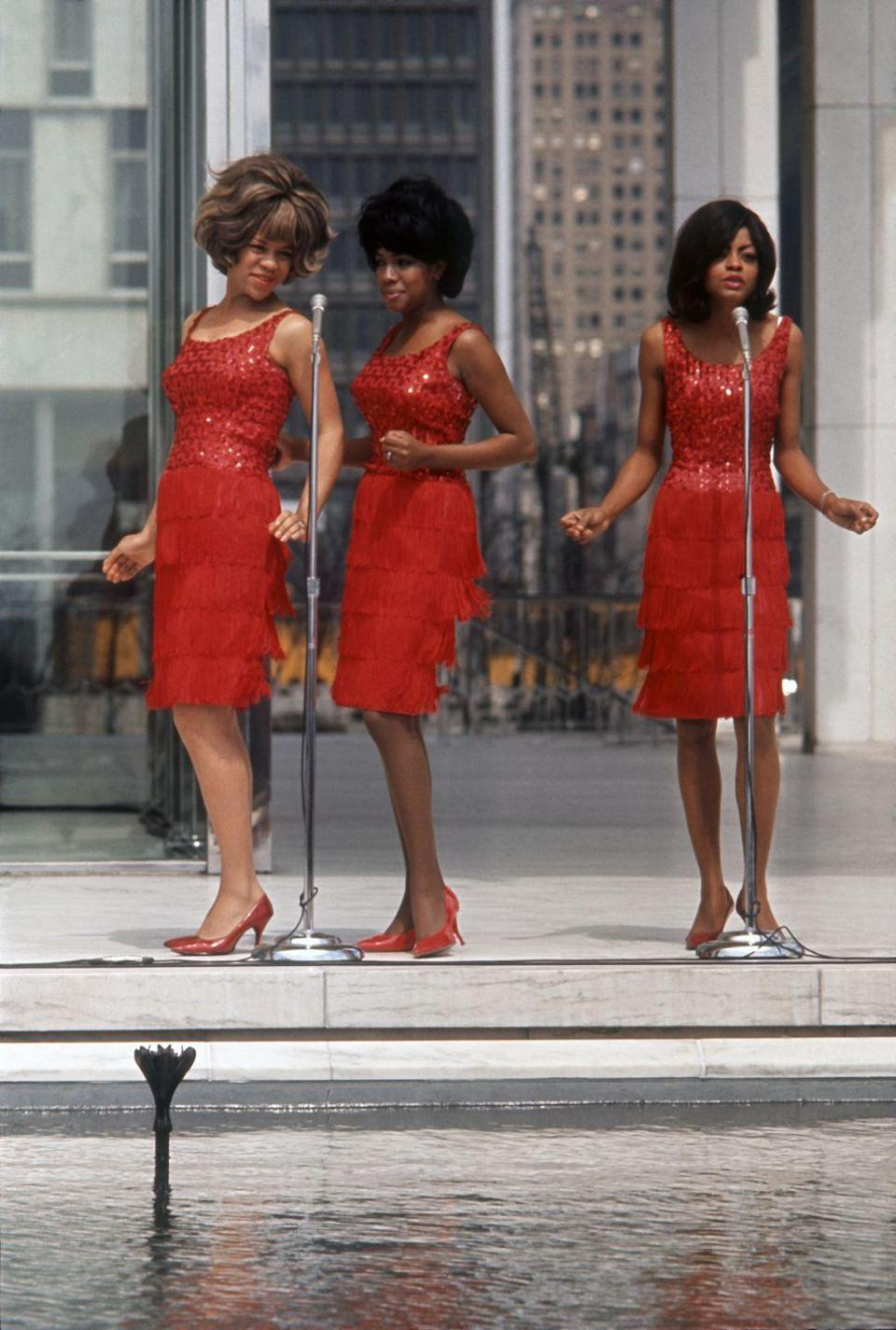 <p>Throughout the '60s, the group became one of Motown's biggest and most successful groups. Here, Mary Wilson, Florence Ballard, and Diana Ross perform in their classic matching outfits in their hometown of Detroit. </p>