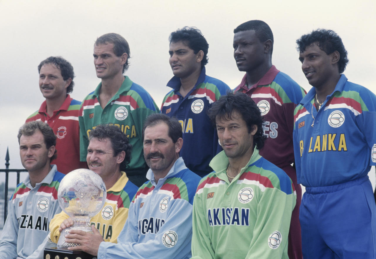 The nine captains posing with the trophy during the opening ceremony of the 1992 Cricket World Cup, Sydney, Australia, February 1992. Standing, left to right: Dave Houghton (Zimbabwe), Kepler Wessels (South Africa), Mohammad Azharuddin (India), Richie Richardson (West Indies), and Aravinda de Silva (Sri Lanka). Seated, left to right: Martin Crowe (New Zealand), Allan Border (Australia), Graham Gooch (England) and Imran Khan (Pakistan). (Photo by Ben Radford/Getty Images)