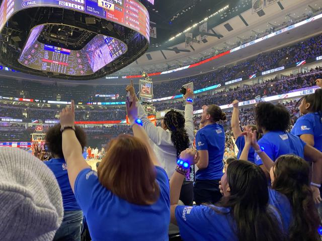 Chicago Scholars students and staff celebrate during the 2020 NBA All-Star Game. Team LeBron's win netted them $400,000. (Henry Bushnell/Yahoo Sports)