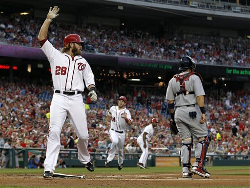 Washington Nationals' Jayson Werth crosses home as Bryce Harper follows behind to score on Adam LaRoche's two-RBI single during the first inning of a baseball game against the St. Louis Cardinals at Nationals Park Friday, Aug. 31, 2012, in Washington. (AP Photo/Alex Brandon)