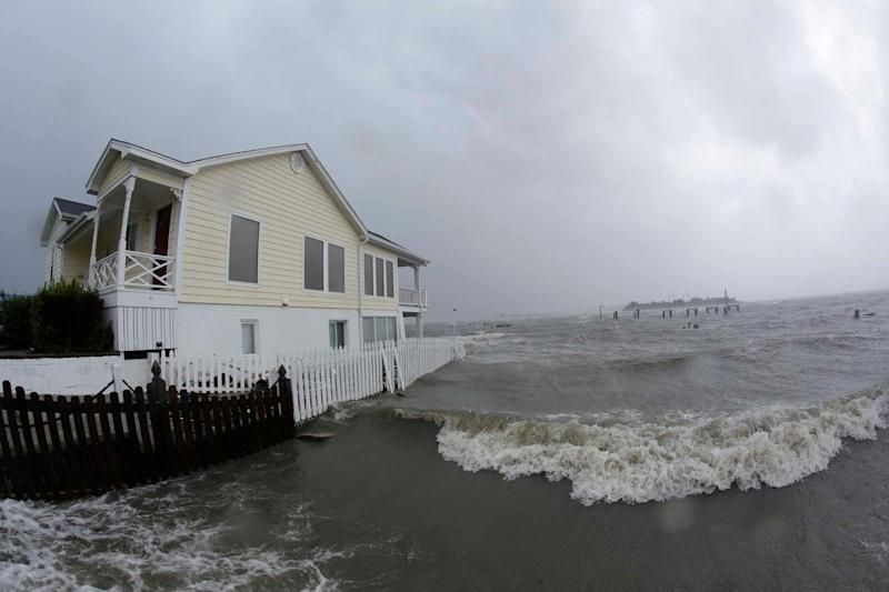 High winds and water surround a house as Hurricane Florence hits Swansboro, North Carolina on Friday.