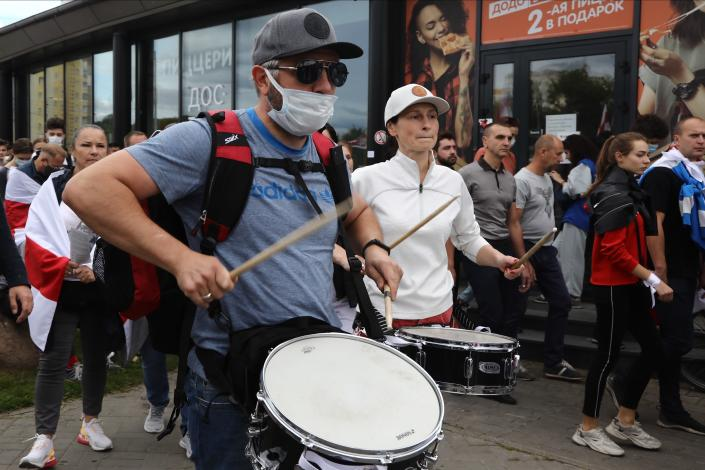 Protesters beat the drums during a Belarusian opposition supporters' rally protesting the official presidential election results in Minsk, Belarus, Sunday, Sept. 13, 2020. Protests calling for the Belarusian president's resignation have broken out daily since the Aug. 9 presidential election that officials say handed him a sixth term in office. (TUT.by via AP)