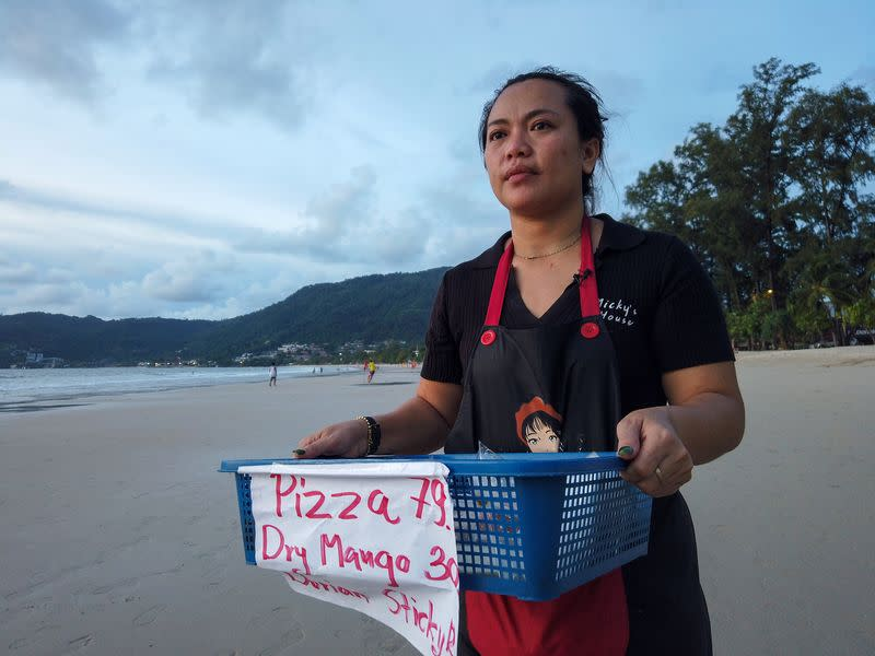 Pimonta sells food on the beach while waiting for the reopening of Phuket