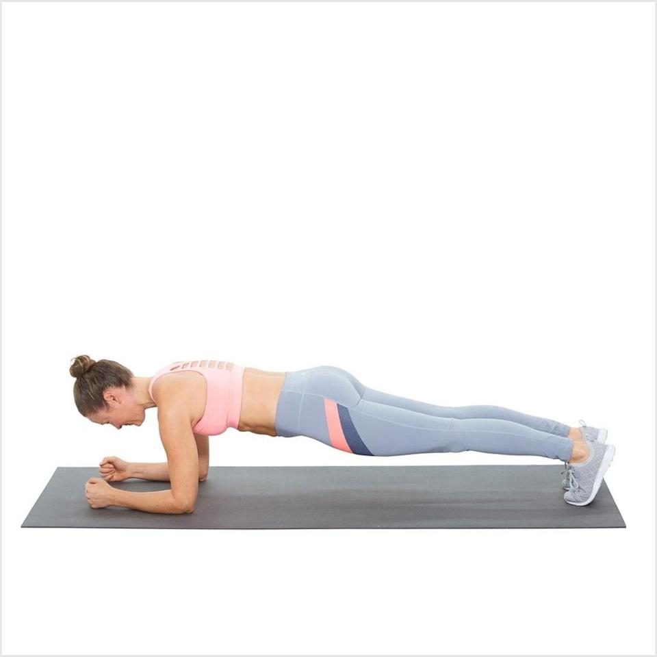 <ul> <li>Start on your forearms and knees, facing the floor with your neck relaxed, your back flat, and your abs pulled toward your spine.</li> <li>Push off the floor, raising up off your knees onto your toes and resting mainly on your elbows. Contract your abdominals to keep yourself up and prevent your butt from sticking up. Keep your back flat and glutes tight.</li> <li>Hold for two rounds of 30 seconds.</li> </ul>
