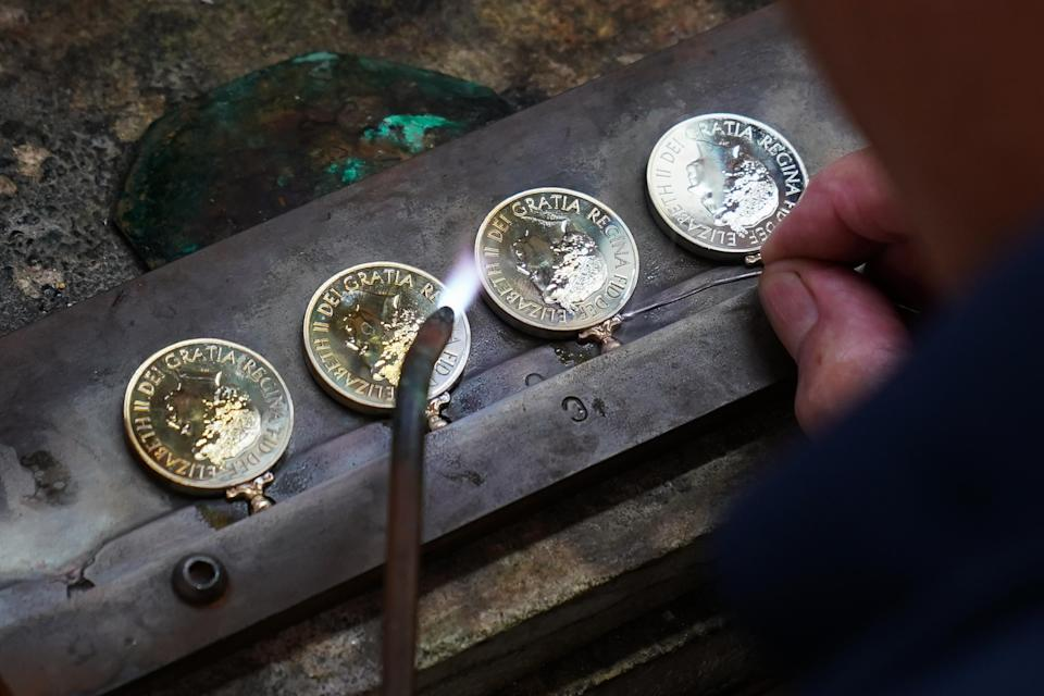 Rings to hold ribbons are soldered to Platinum Jubilee medals (Joe Giddens/PA)