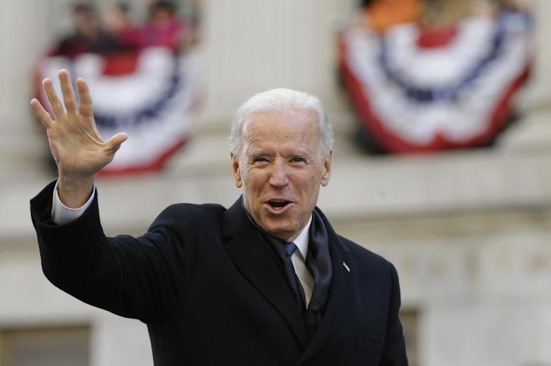 FILE - In this file photo taken Jan. 21, 2013, Vice President Joe Biden waves to the crowd as he walks down Pennsylvania Avenue towards the White House in Washington. With his political future tied irrevocably to President Barack Obama, Biden is still working to preserve his own, distinct identity as he contemplates a third presidential run in 2016.  (AP Photo/Carolyn Kaster)