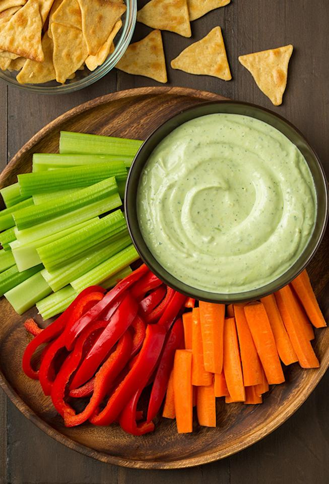 """<p>Instead of mayonnaise, this dip is made with a combination of Greek yogurt and pureed avocado, meaning you'll get a good dose of protein and healthy fats along with your crudité. Get the recipe <a rel=""""nofollow"""" href=""""http://www.cookingclassy.com/avocado-greek-yogurt-ranch-dip?mbid=synd_yahooFood"""">here</a>.</p>"""