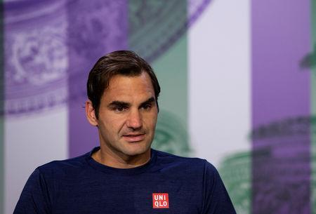 FILE PHOTO: Tennis - Wimbledon - All England Lawn Tennis and Croquet Club, London, Britain - July 11, 2018. Switzerland's Roger Federer attends a press conference after loosing his quarter final match against South Africa's Kevin Anderson . Florian Eisele/AELTC pool via Reuters/FIle Photo