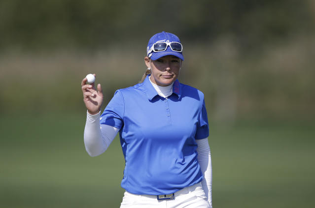 Katherine Hull-Kirk of Australia acknowledges the gallery's cheers after she finished her first round with a five-under par 67 on the ninth hole during the first round of the LPGA KEB Hana Bank Championship golf tournament at Sky72 Golf Club in Incheon, west of Seoul, South Korea, Friday, Oct. 18, 2013. Katherine Hull-Kirk finished her first round in the lead with South Korea's Amy Yang, Park Ju-young and Anna Nordqvist of Sweden, with a five-under par 67. (AP Photo/Lee Jin-man)