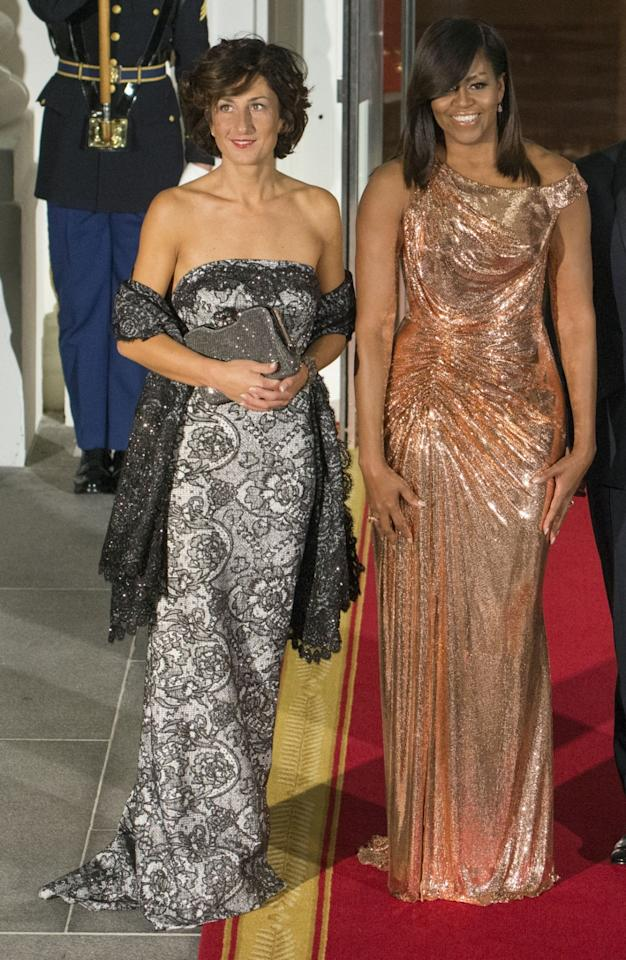 """<p>As Rashida Jones wrote in a recent """"love letter"""" on <em>T</em>, Michelle Obama """"will have her own legacy, separate from her husband's."""" And one of those things (including all of her incredible work with young girls and heath) will be her amazing fashion. At her final state dinner hosting Italy, the first lady dazzled in a custom Atelier Versace gown in rose gold made entirely of chain mail. (Photo: Getty Images) </p>"""