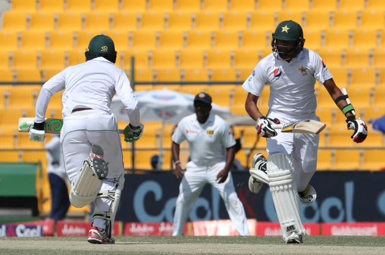 Harris Sohail (R) and Muhammad Abbas of Pakistan run between the wickets during a Test match against Sri Lanka, at Sheikh Zayed Stadium in Abu Dhabi, on October 1, 2017