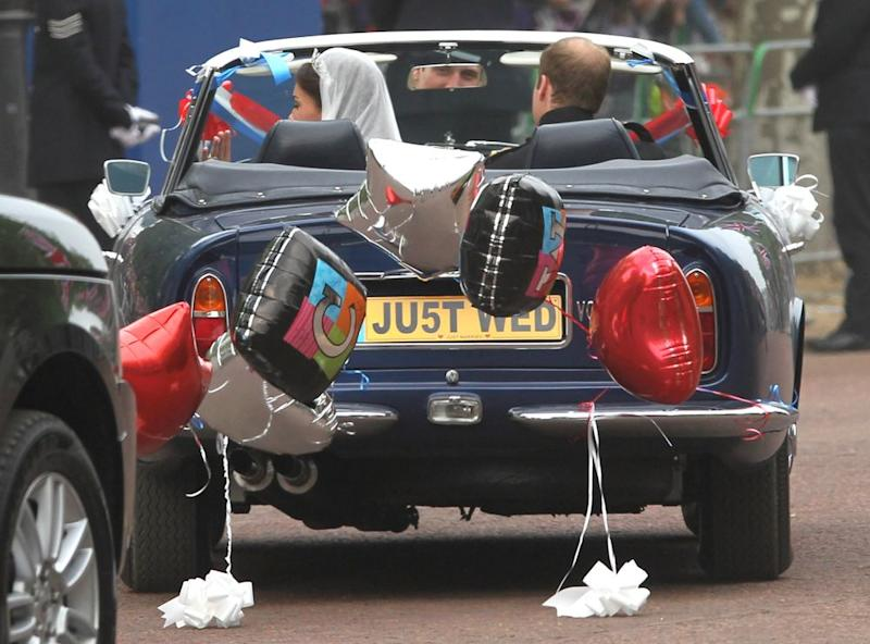 Prince William and Kate Middleton in their getaway car on their wedding day in April 2011