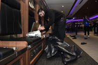 Baltimore Ravens tight end Mark Andrews cleans out his locker Sunday, Jan. 12, 2020 in Owings Mills, MD. (AP Photo/Gail Burton)