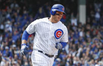 Chicago Cubs' Anthony Rizzo rounds the bases after hitting three-run home run off of St. Louis Cardinals starting pitcher Jack Flaherty during the third inning of a baseball game, Friday, May 3, 2019, in Chicago. (AP Photo/Kamil Krzaczynski)