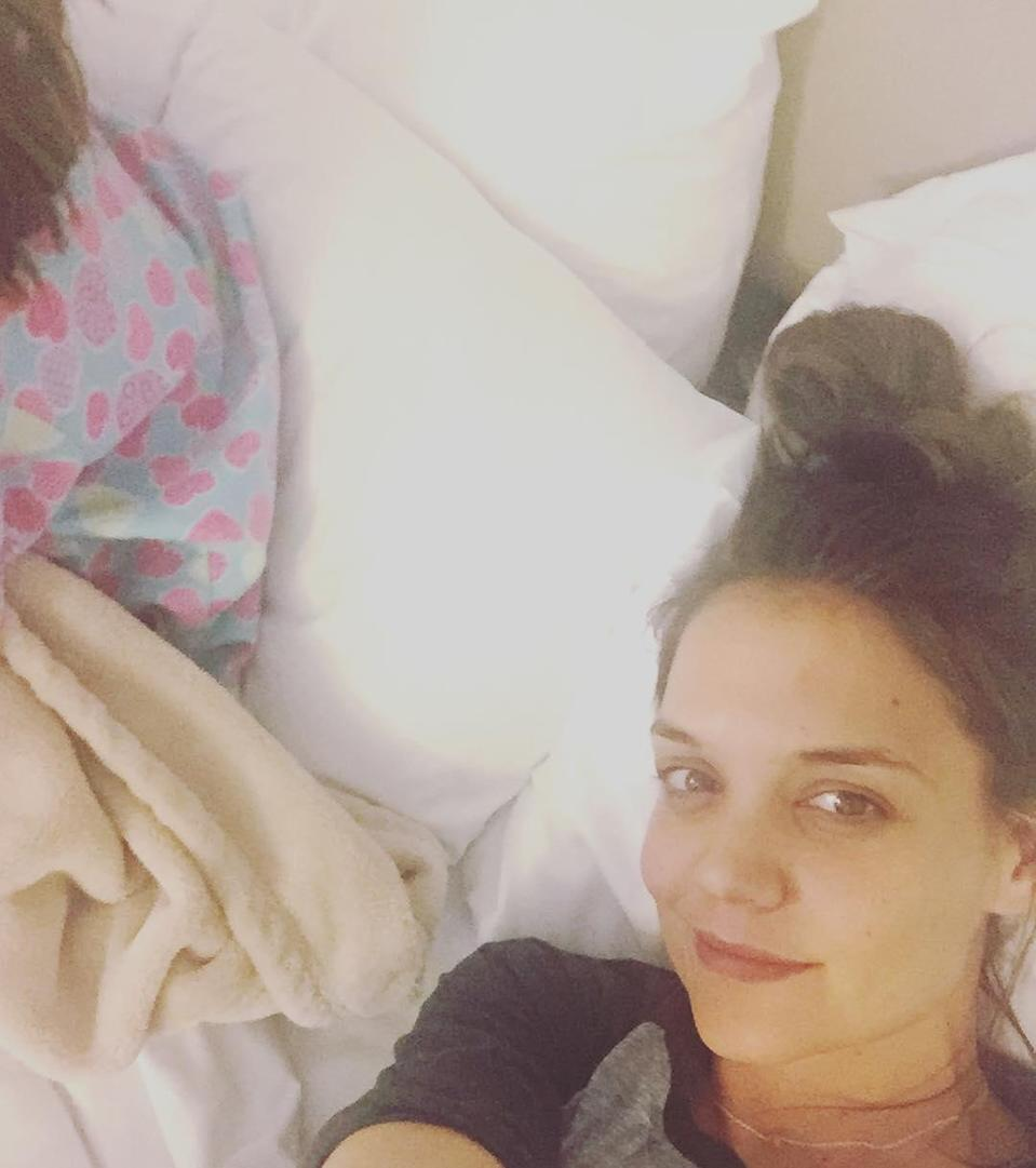 We can't see Suri's face in this photo that Katie posted of their mother-daughter sleepover, but we're betting that, sans makeup, the two look even more alike than they usually do.