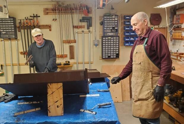 Volunteers Doug and Steve work on the bat boxes for the Annapolis Valley Bat Box Project.