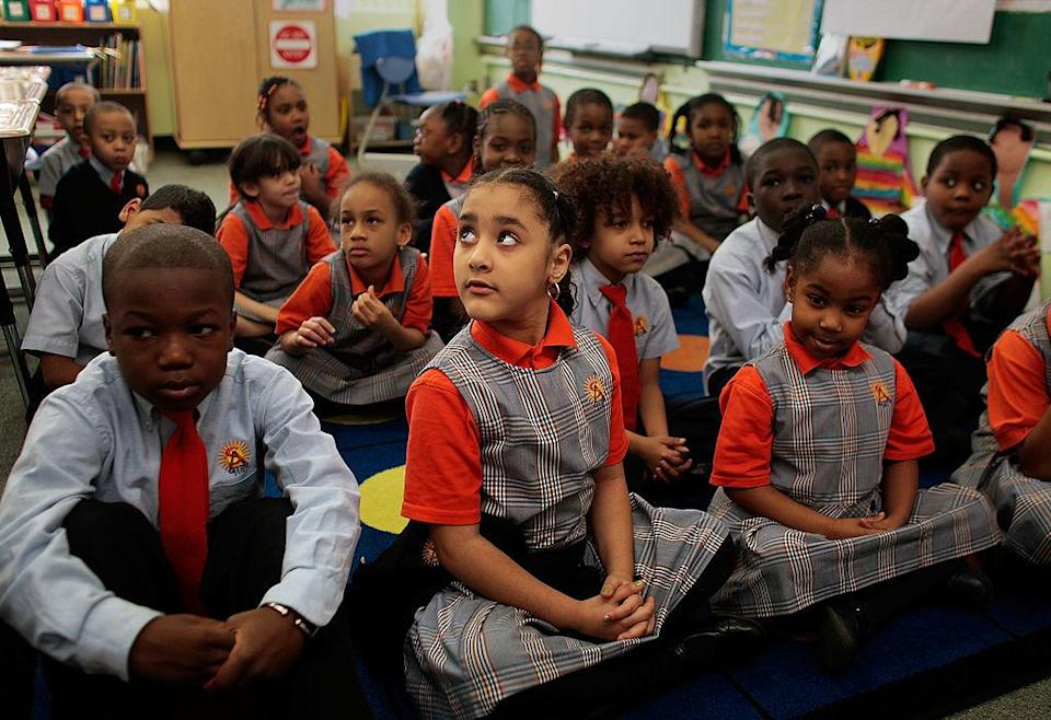 In the first few months of Mayor Bill de Blasio's tenure, he attempted to block three schools in the high-performing Success Academy network from co-locating in district-owned facilities. Seen here is a 2009 photo of a classroom at the Harlem Success Academy. (Chris Hondros / Getty Images)