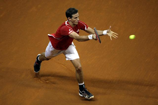Canada's Vasek Pospisil returns the ball to Serbia's Janko Tipsarevic during their Davis Cup semifinals tennis match in Belgrade, Serbia, Sunday, Sept. 15, 2013. (AP Photo/ Marko Drobnjakovic)