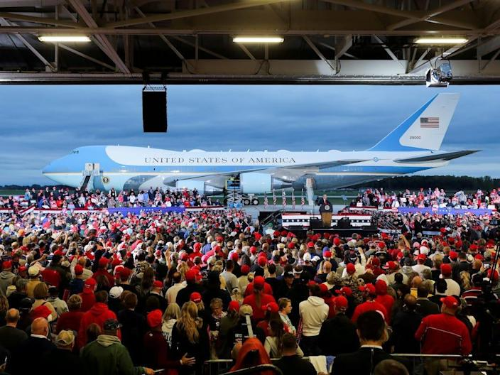 """President Donald Trump speaks at a campaign event at MBS International Airport in Freeland, Michigan, on Thursday, with Air Force One in the background. <p class=""""copyright"""">Jonathan Ernst/Reuters</p>"""