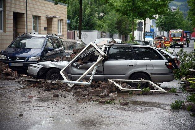 Debris covers the road after an explosion at a house in western Germany.