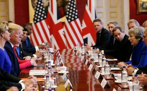 Donald Trump and Theresa May sit at the centre of the table - Credit: Tim Ireland/AP