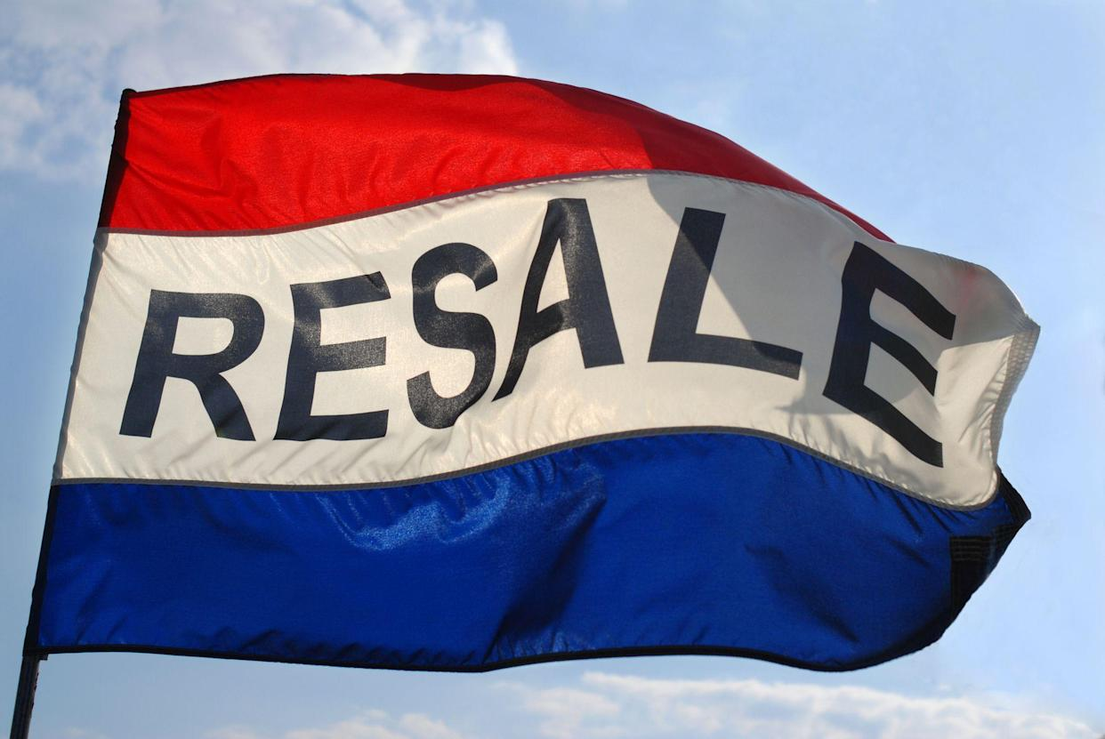 Resale flag flying in the wind against a slightly cloudy sky.
