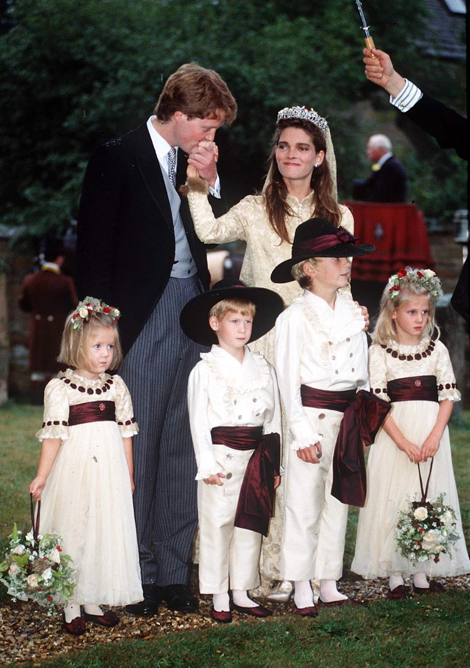 GREAT BRINGTON, UNITED KINGDOM - SEPTEMBER 16:  Viscount Althorp (charles Spencer) Kissing The Hand Of Bride, Victoria Lockwood. Bridesmaids And Pageboys (l To R)  Eleanor Fellowes, Prince Harry, Alexander Fellowes  Emily Mccorquodale.wedding Outfit By Tomasz Starzewski  (Photo by Tim Graham Photo Library via Getty Images)