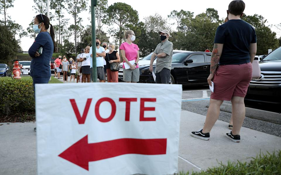 Voters line up to cast their ballots during early voting in Celebration, Florida, Oct. 25. (Photo: Gregg Newton / Reuters)