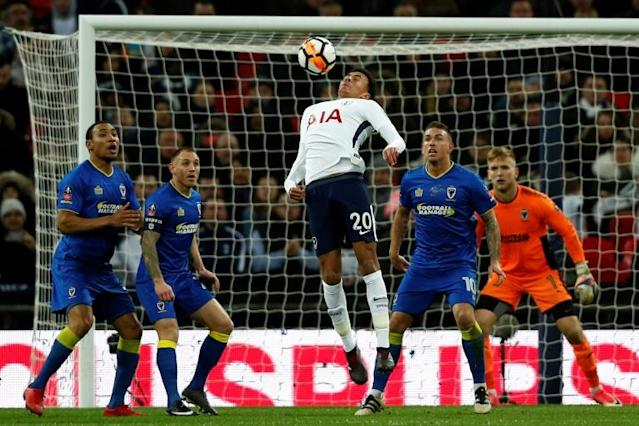 Tottenham Hotspur midfielder Dele Alli (C) controls the ball during his side's English FA Cup third round match against AFC Wimbledon