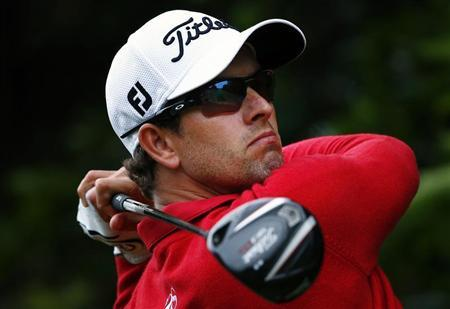 Australia's Adam Scott hits a drive on the second hole during the second round of the Australian Open golf tournament at Royal Sydney Golf Club