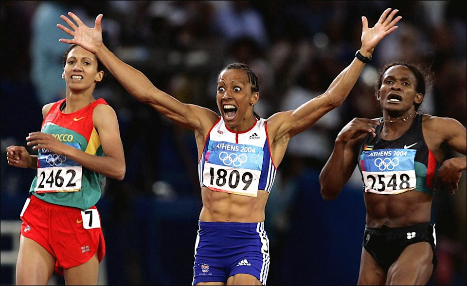Dame Kelly Holmes, centre, celebrates her 800m win in Athens (Phil Noble/PA) (PA Archive)