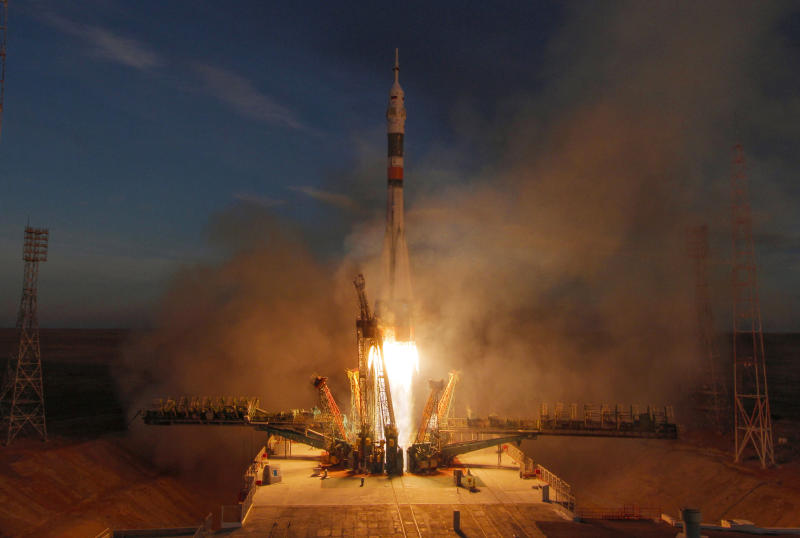 The Soyuz-FG rocket booster with Soyuz MS-11 space ship carrying a new crew to the International Space Station, ISS, blasts off at the Russian leased Baikonur cosmodrome, Kazakhstan, Monday, Dec. 3, 2018. The Russian rocket carries U.S. astronaut Anne McClain, Russian cosmonaut Оleg Kononenko‎ and CSA astronaut David Saint Jacques. (AP Photo/Dmitri Lovetsky)